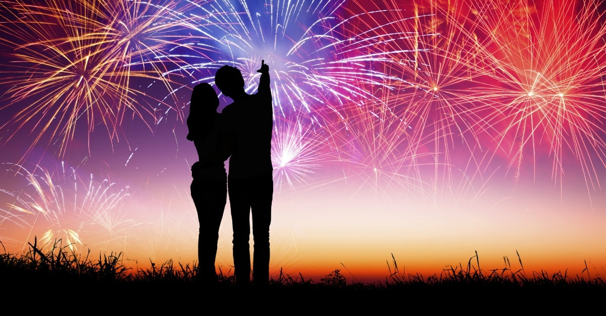 13444-couple-fireworks-light-sky-wide.1200w.tn